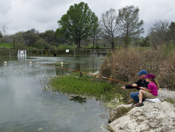 man and daughter fishing on Blanco River