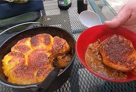 Dutch oven with chili and cheesy biscuits