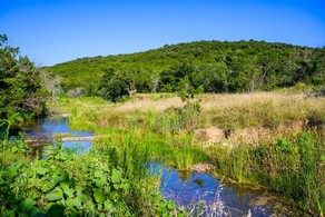 Scenic Palo Pinto hill and creek
