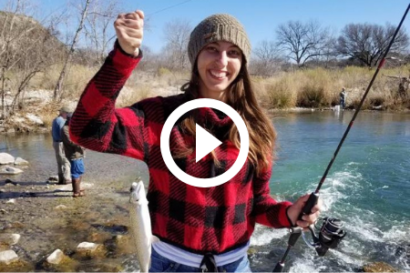 Woman with fish at river, video link