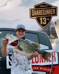 Jr. angler holding Legacy-class Lunker
