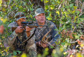 Two men stalking deer