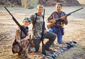 3 dove hunters with their harvest