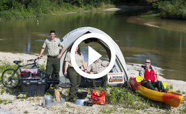 Texas Outdoor Family instructors by tent, video link