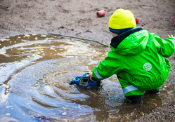 Child Playing in Flood Waters