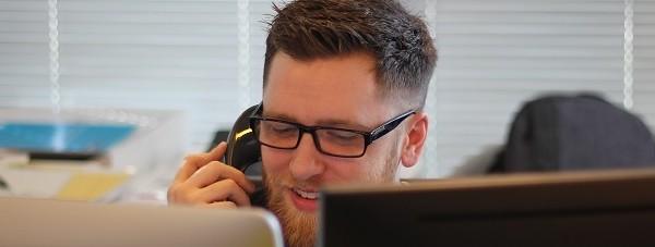 man in office talking on phone