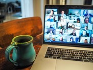 Photo of a Computer Screen with video conference call participants and coffee mug
