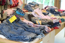 Used clothes stacked on table