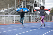 Laura Muir and Kadeena Cox test out the new warm-up track at the Alexander Stadium