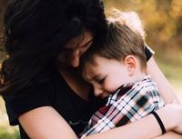 mum hugs son