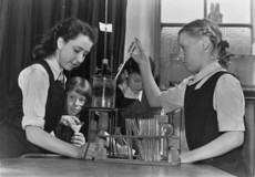 Image of four school girls conducting a science experiement