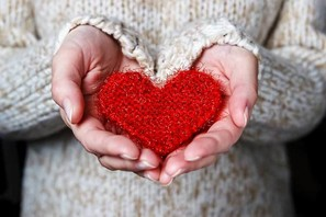 Knitted heart held in hands