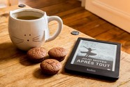 Image of ebook next to a coffee cup