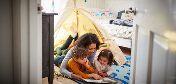 Making a den and reading a book - fun activities at home