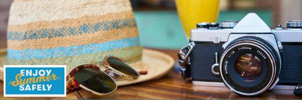 Sun hat sunglasses and camera