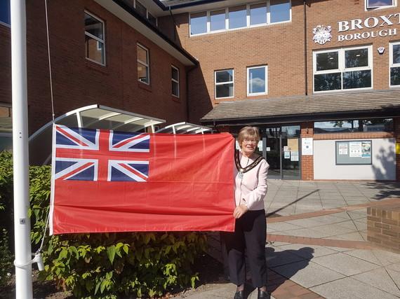 The Mayor raising the merchant navy flag