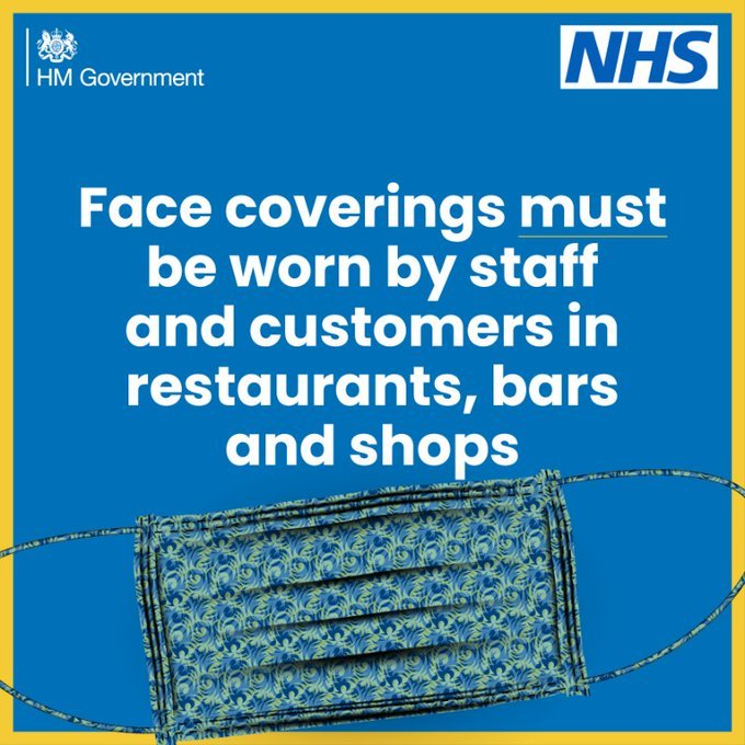 Face coverings must be worn by staff and customers in restaurants, bars and shops on blue background with yellow border and face covering