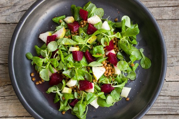 Green beetroot and pear salad meal on a plate