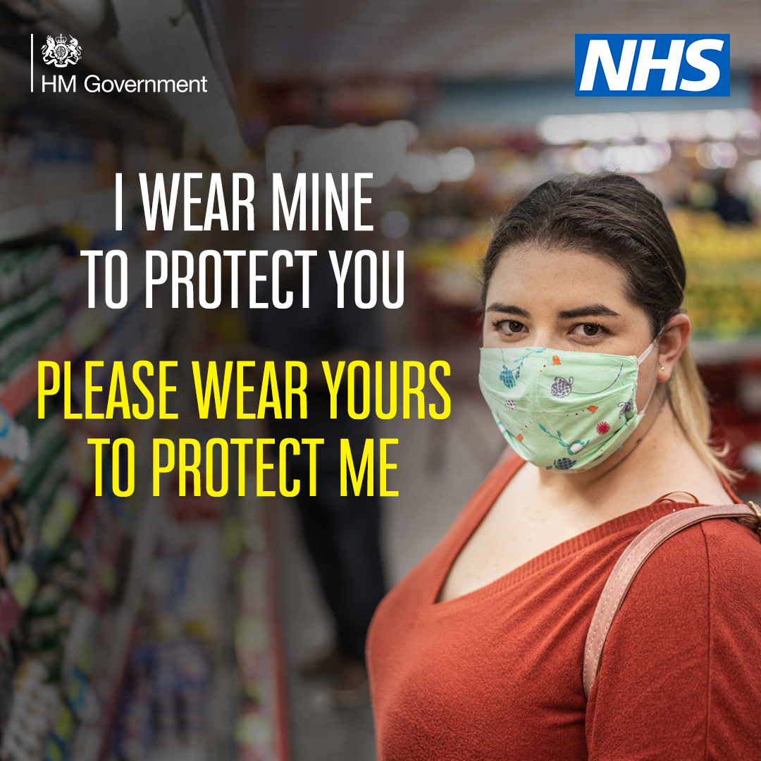 Woman in shop wearing face covering I wear mine to protect you, please wear yours to protect me