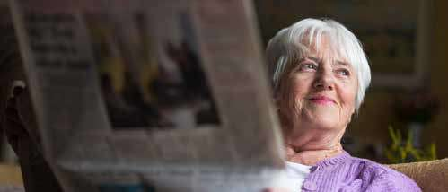 Woman in her 70's with a newspaper