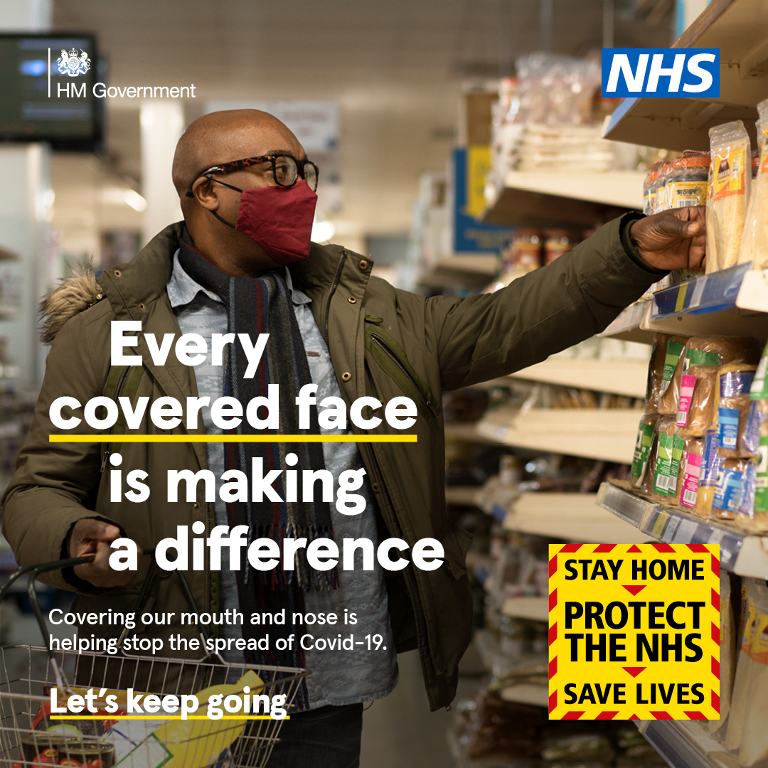 Every covered face is making a difference man in supermarket wearing a face covering