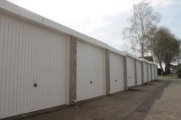 Frontage of Caldbeck Garages - white garage doors