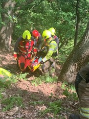 Fire service carrying injured person in practice scenario