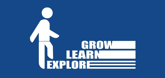 person walking up steps that say grow, learn and develop