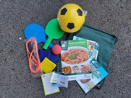 Kids activity pack with sports equipment and recipe books