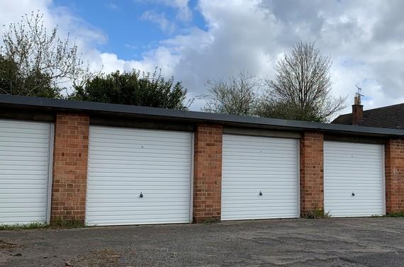 White door garages against a blue sky