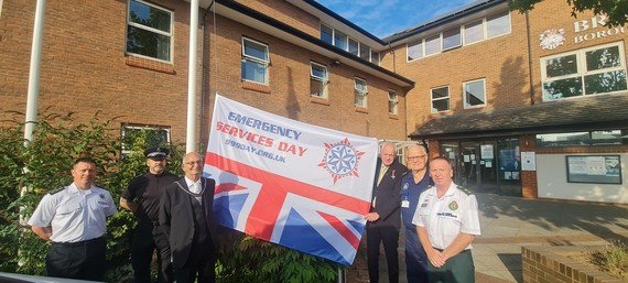 The Deputy Mayor raising the flag for Emergency Services Day 2021