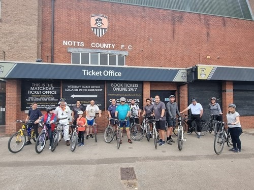 Participants of the bike ride in front of Notts County Football Club