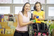 Girl in wheelchair with carer