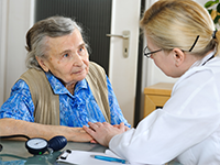 Elderly patient with doctor
