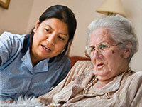 Resident and carer in care home