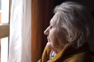 Lady looking out of window
