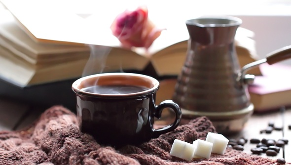 Cosy image of coffee and a book