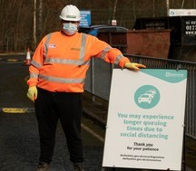 recycling centre sign warning of queues