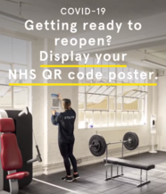 QR code poster being put up in a gym