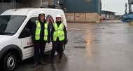 Two trading standards officers standing in front of a van at Teignmouth docks
