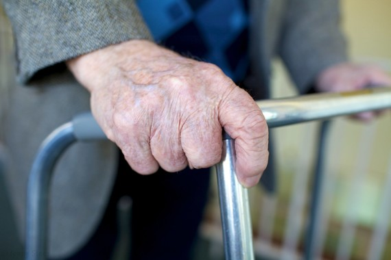 elderly man's hands on a walking frame