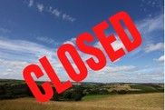 Devon is closed - rural landscape with closed written in red
