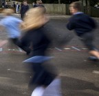 blurred primary school children playing