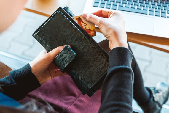 woman getting a credit card out of her purse