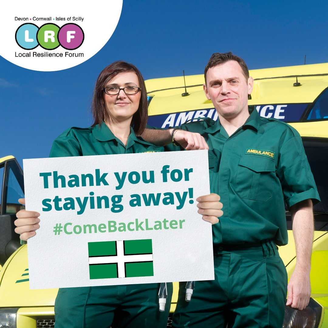 male and female ambulance crew holding a sign saying thank you for staying away #comebacklater