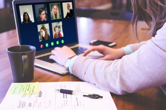 lady video conferencing on laptop