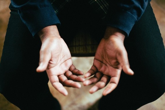 upturned hands in prayer