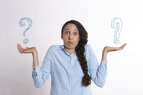 lady stood with question marks in her hands