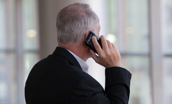 man in suit on a phone