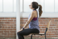 woman on chair doing exercise